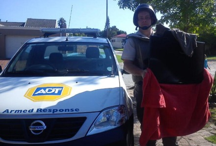 ADT Security Armed Response Officer Adriaan van Rensburg with the recovered flat-screen television.