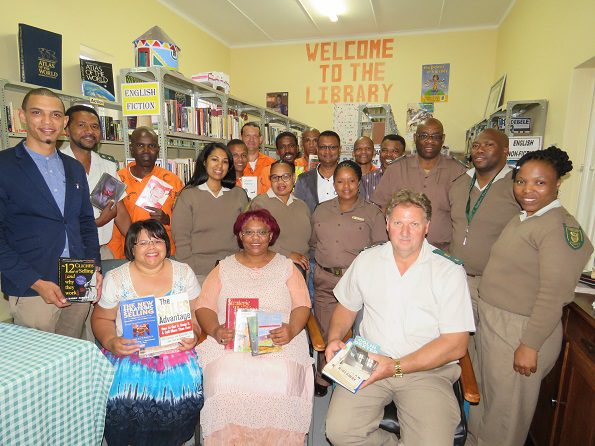 All of the Role players with the handing over of the books at the George Correctional Centre library