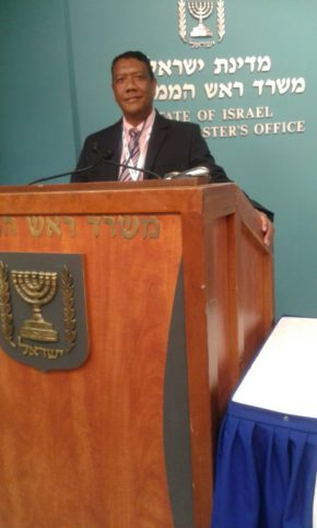 In the second photograph Ald Naik is seen addressing the media at the office of the Prime Minister of Israel, Benjamin Netanyahu