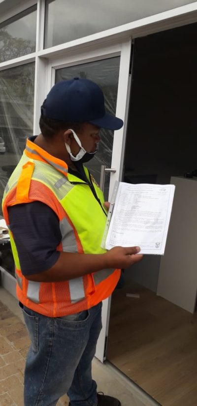 A  Law Enforcement Officer checks if a Covid-19 Lockdown permit is in order