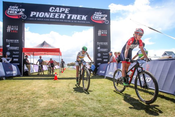 Cherie Redeker leads Mariske Strauss across the finish line to win the women's category of the prologue stage of the 2016 Cape Pioneer Trek international mountain bike stage race in Mossel Bay, South Africa on Sunday. Photo credit: www.oakpics.com