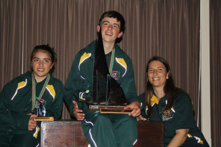 The Hellstrom family. James (centre) is the new RS Tera Pro World Champion. Here he and his sister Robyn are with their unique trophies, crafted in Knysna